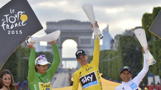 Team Sky rider Chris Froome of Britain, the race leader's yellow jersey, celebrates his overall victory on the podium after the final 21st stage of the 102nd Tour de France cycling race