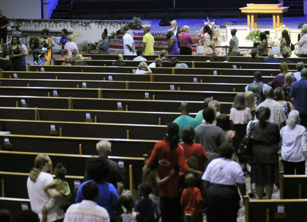 Mourners file past the casket of 8-year-old Cherish Perrywinkle during a viewing at Paxon Revival Center Church on Thursday, June 27, 2013 in Jacksonville, Fla. Cherish, who police say was targeted by