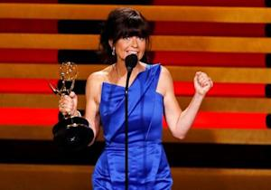 """Director Gail Mancuso accepts the award for Outstanding Directing For A Comedy Series for """"Modern Family"""" during the 66th Primetime Emmy Awards in Los Angeles"""