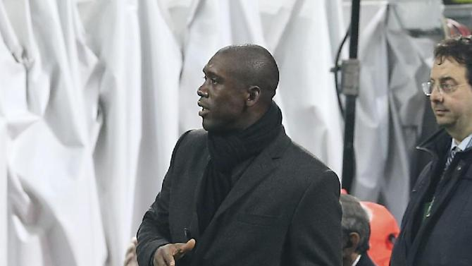 AC Milan coach Clarence Seedorf, of the Netherlands, gestures during the Italian Cup soccer match between AC Milan and Udinese at the San Siro stadium in Milan, Italy, Wednesday, Jan. 22, 2014