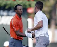Henrik Stenson of Sweden (R) shakes hands with playing partner Tiger Woods of the U.S. after they completed their round during the first round of the Tour Championship golf tournament at East Lake Golf Club in Atlanta, Georgia, September 19, 2013. REUTERS/Tami Chappell