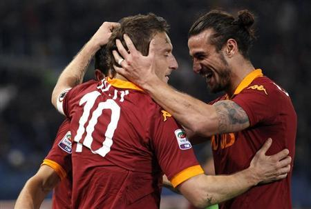 AS Roma's Totti celebrates with teammate Osvaldo after scoring against Juventus during their Italian Serie A soccer match at the Olympic stadium in Rome