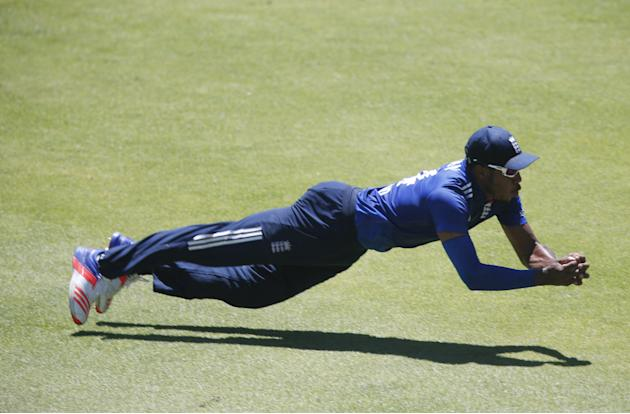 England's Jordan takes a catch to dismiss South Africa's de Villiers during their second One-Day International cricket match in Port Elizabeth