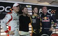 (L-R) Michael Schumacher and Sebastian Vettel from Team Germany, Romain Grosjean from Team France and David Coulthard from Team Great Britain pose for photographers after a news conference for the Race of Champions at the Rajamangala National Stadium in Bangkok December 15, 2012. REUTERS/Chaiwat Subprasom/Files