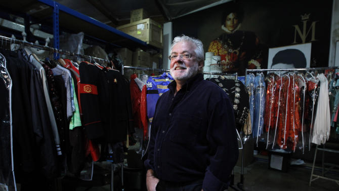 "In this image taken on Thursday, June 21, 2012, Michael Jackson's longtime costume and clothing designer, Michael Bush, poses for photos in Los Angeles. Bush tells the King of Pop's style secrets in a new photo-filled book, ""The King of Style: Dressing Michael Jackson"" to be released on October 30, 2012. (AP Photo/Jae C. Hong)"