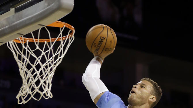 Los Angeles Clippers' Blake Griffin dunks during the first half of a preseason NBA basketball game against the Denver Nuggets on Saturday, Oct. 19, 2013, in Las Vegas