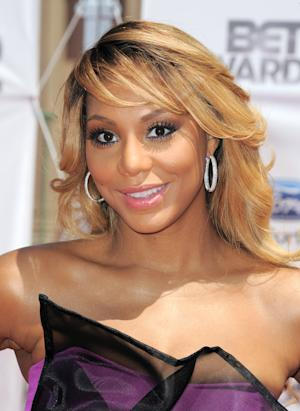 """FILE - This July 1, 2012 file photo shows Tamar Braxton at the BET Awards in Los Angeles. Braxton debuted at No. 13 and No. 5 with """"Love & War"""" on Billboard's R&B/Hip-Hop songs and R&B songs charts, respectively. The 35-year-old has been buzzing since a reality show starring her and her sisters premiered on WEtv last year. Her spotlight grew brighter when a spin-off with her husband Vincent Herbert _ who manages Lady Gaga _ kicked off this year. (Photo by Jordan Strauss/Invision/AP, file)"""