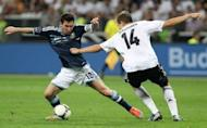 Argentina's striker Lionel Messi (L) tries to pass Germany's defender Holger Badstuber during the friendly match in Frankfurt am Main, western Germany. Argentina won 3-1