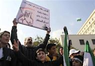Syrians living in Egypt shout slogans against Syrian President Bashar al-Assad during a protest outside the Arab League offices in Cairo
