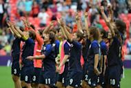 Japan's women footballers celebrate after defeating France in the women's football semi-final at the Olympics on August 6. The team has bagged themselves an upgrade on their plane ride home from the Olympics, their coach said, after a sexism row over their flight to Europe ahead of the Games