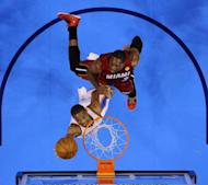 Oklahoma City Thunder's Russell Westbrook (L) goes up for a shot against Miami Heat's Juwan Howard (R) during game one of the NBA Finals on June 12. Westbrook was just three assists short of his career high (14) for a playoff game