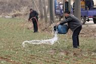 Villagers irrigate a wheat field with water collected from a nearby pond in drought-affected Songxian county, Henan province, Feb. 22, 2011. China's wheat production is likely not to meet the government's forecast