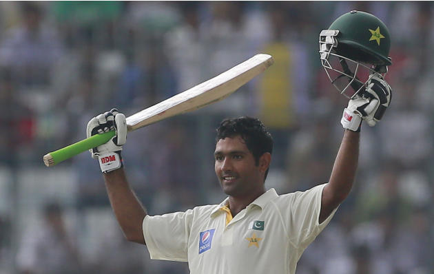 Pakistan's Asad Shafiq acknowledges the crowd after scoring a century during the second day of the second test cricket match against Bangladesh in Dhaka, Bangladesh, Thursday, May 7, 2015. (AP Photo/