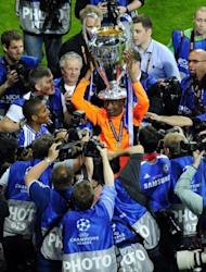 Chelsea's forward Didier Drogba (C) celebrates with the trophy after the UEFA Champions League final. Drogba was the hero as Chelsea shattered Bayern Munich's Champions League dream with victory in a nail-biting penalty shoot-out