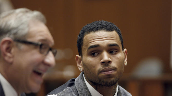 FILE - In this Monday, Sept. 24, 2012 file photo, Chris Brown appears in a Los Angeles courtroom with his attorney Mark Geragos. Judge Patricia Schnegg has ordered a further review of Brown's community service and travel to determine whether he has violated the terms of his probation for the 2009 beating of then-girlfriend Rihanna. (AP Photo/David McNew, Pool, File)