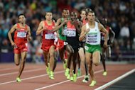 Algeria's Taoufik Makhloufi (R) competes with (from L) Morocco's Abdalaati Iguider, US athlete Matthew Centrowitz, Ethiopia's Mekonnen Gebremedhin and Kenya's Silas Kiplagat in the men's 1500m final at the London Olympics on August 7