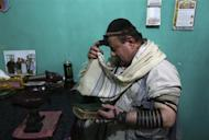 Zabulon Simintov, an Afghan Jew, prays at his residence in Kabul November 5, 2013. REUTERS/Omar Sobhani
