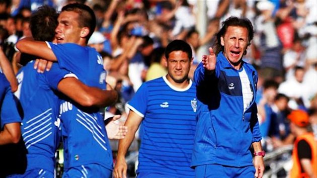 Velez Sarsfield's head coach Ricardo Gareca, assistant coach Jose Flores and players celebrate a goal during their final against Union in Buenos Aires (Reuters)