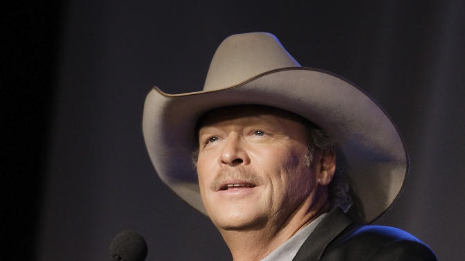 "FILE - Alan Jackson speaks as he is inducted into the Nashville Songwriters Hall of Fame, in Nashville, Tenn. The release of his latest album ""Thirty Miles West"" caps an emotional period for the 53-year-old and his family. His wife has now been cancer free for a year. And Jackson split with Arista Nashville, ending a two-decade partnership that produced more than 43 million albums sold. He signed with Capitol/EMI Records Nashville and ""Thirty Miles West"" is out on his own imprint, ACR.    (AP Photo/Mark Humphrey, File)"