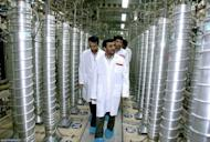 """Iranian President Mahmoud Ahmadinejad inspects centrifuges during a visit to the Natanz uranium enrichment facility in 2008. Iran """"will not retreat an iota"""" from its nuclear rights, Ahmadinejad has said, ahead of weekend talks in Istanbul with world powers over Tehran's atomic activities"""