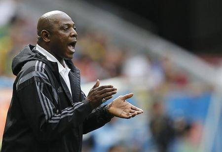 Nigeria's coach Keshi cheers on his team during their 2014 World Cup round of 16 game against France at the Brasilia national stadium in Brasilia