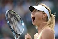 Russia's Maria Sharapova celebrates during her third round women's singles victory over Taipei's Hsieh Su-Wei at Wimbledon. Sharapova cruised to a 6-1, 6-4 victory over Hsieh to set up a repeat of last year's Wimbledon semi-final against Germany's Sabine Lisicki