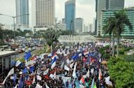 Thousands of Indonesian workers march towards the presidential palace during the May Day protests in Jakarta on May 1. Indonesian workers held a peaceful rally in Jakarta on May 1 demanding better pay and protection of job security