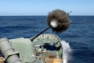 File picture. A handout photo taken on February 19, 2010 shows HMAS Anzac conducting a 5-inch gun live firing drill in the East Australian Exercise Area during the Fleet Concentration Period. Navy chief Vice Admiral Ray Griggs ordered an investigation into security on all naval ships and bases after an intruder robbed an Australian navy vessel of a cache of weapons.