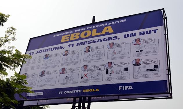"A board bearing the ""11 against Ebola"", a joint campaign between FIFA, the CAF and health experts, to raise awareness in the fight against Ebola on December 17, 2014"