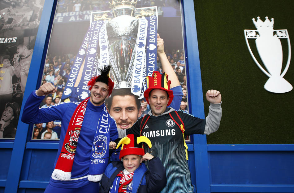 Chelsea fans pose for a photo outside the ground before the match