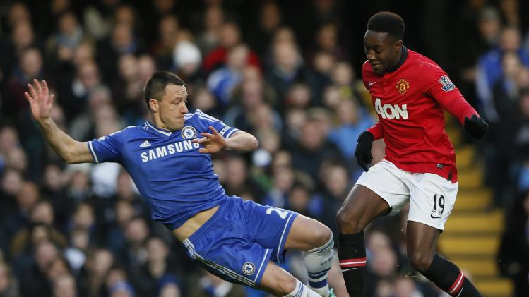 Chelsea's Terry challenges Manchester United's Welbeck during their English Premier League soccer match at Stamford Bridge