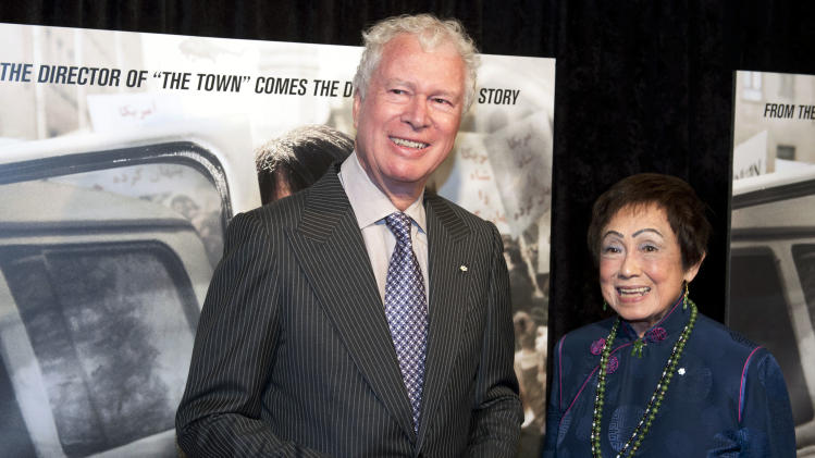 "FILE - In this Wednesday, Oct. 10, 2012 file photo, former Canadian Ambassador Ken Taylor and his wife Pat, pose for photographers at the premiere of the film Argo in Washington. Taylor, Canada's former ambassador in Iran, who protected Americans at great personal risk during the Iran hostage crisis of 1979, says if ""Argo"" wins the Oscar for best picture on Sunday there would be something wrong with director Ben Affleck if he didn't mention Canada, Friday, Feb. 22, 2013. (AP Photo/Cliff Owen, File)"