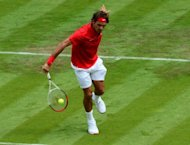 Switzerlands' Roger Federer returns the ball to Colombia's Alejandro Falla during the men's single tennis match at the London 2012 Olympic Games in London. Federer won 6-3, 5-7, 6-3