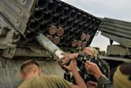 Ukrainian soldiers charge a Grad multiple rocket launcher system, near the eastern Ukrainian city of Shchastya, Lugansk region, on August 18, 2014