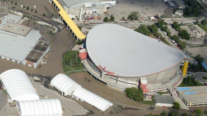 This photo shows a flooded Calgary Saddledome Saturday, June 22, 2013 in Calgary, Alberta. The Saddledome, home to the National Hockey League's Calgary Flames, was flooded up to the 10th row, leaving the dressing rooms submerged. The two rivers that converge on the western Canadian city of Calgary are receding Saturday, June 22, 2013 after floods devastated much of southern Alberta province, causing at least three deaths and forcing thousands to evacuate. (AP Photo/The Canadian Press, Jonathan Hayward)