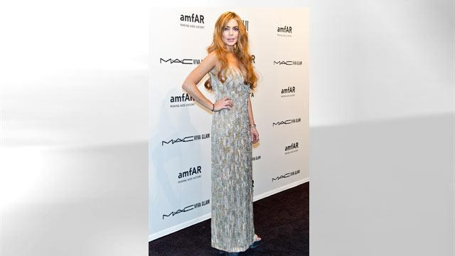 Lohan Reportedly Mangles Loaned Dress