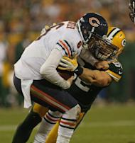 Clay Matthews of the Green Bay Packers sacks Jay Cutler of the Chicago Bears at Lambeau Field on September 13, in Green Bay, Wisconsin. The Packers defeated the Bears 23-10