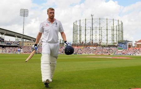 England's Flintoff leaves the field after being caught for 22 during the fifth Ashes cricket test match against Australia at the Oval, London