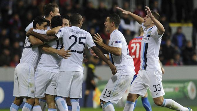 Manchester City's players celebrate their first goal during the Champion's League Group D soccer match against Viktoria Plzen in Plzen, Czech Republic, Tuesday, Sept. 17, 2013. (AP Photo, CTK/Michal Kamaryt)