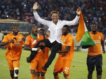 Ivory Coast's head coach Renard celebrates with his players after winning the African Nations Cup final match against Ghana in Bata