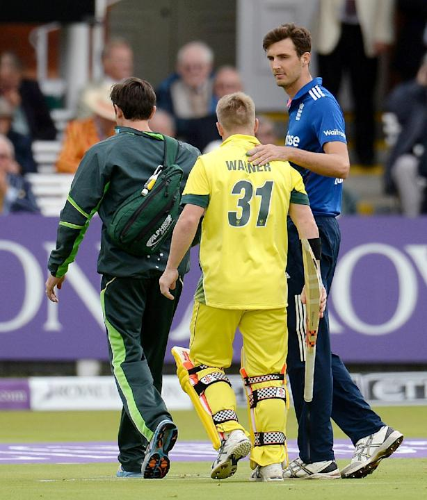 England's Steven Finn consoles Australia's David Warner as he leaves the field injured