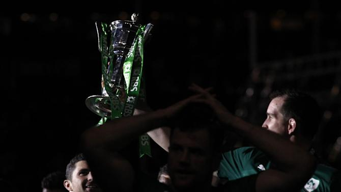 Ireland's rugby team players hold the trophy after defeating France and winning the Six Nations Rugby Union tournament at the stade de France stadium, in Saint Denis, outside Paris, Saturday, March 15, 2014. (AP Photo/Christophe Ena)