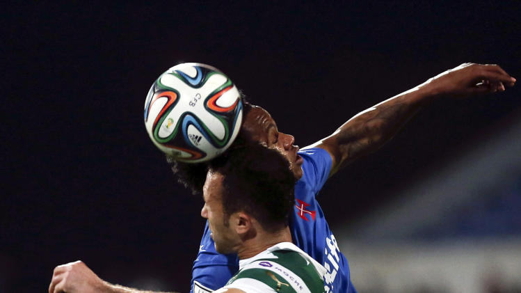Sporting wins to delay Benfica's title