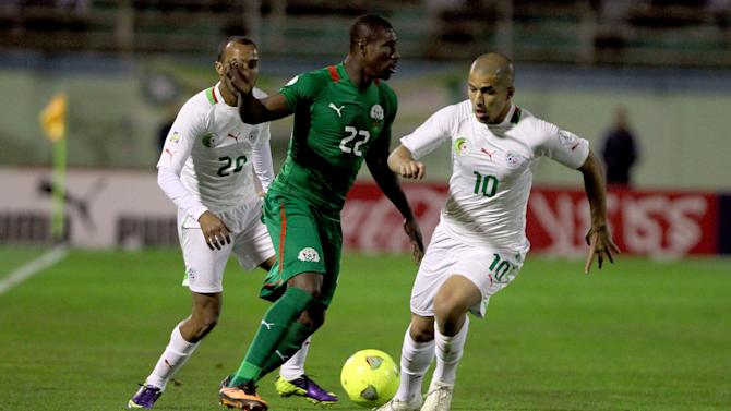 ALGIERS, Nov. 20, 2013 (Xinhua/IANS) -- Algeria's Sofiane Feghouli (R) controls the ball during the 2014 World Cup qualifying second leg playoff soccer match against Burkina Faso in Algiers, Algeria, on Nov. 19, 2013. Algeria won 1-0 and qualified for the final stage of 2014 World Cup. (Xinhua/Mohamed Kadri)
