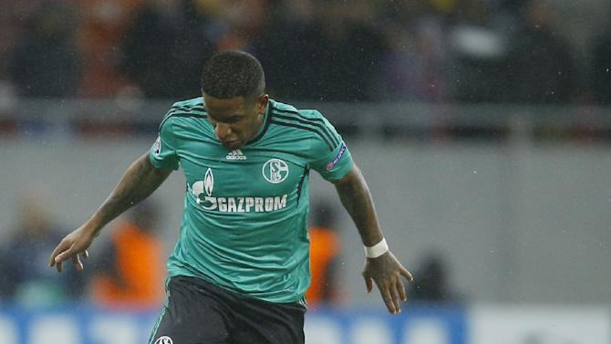 Schalke's Jefferson Farfan, top, in action with Bucharest's Gabriel Iancu, bottom, during their Champions League Group E soccer match, at the National Arena in Bucharest, Romania, Tuesday, Nov. 26, 2013