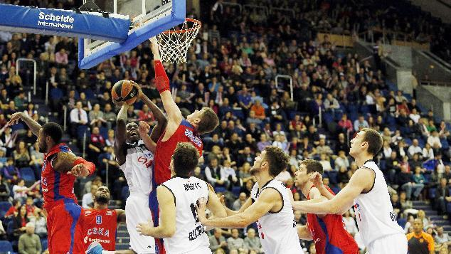 Partisan's Boris Dallo, third left, tries to score as CSKA's Andrey Vorontsevich, center, jumps and blocks him, with teammate Sonny Weems, left, and Aaron Jackson, second left, during their Euroleague basketball match between CSKA Moscow and Partizan NIS Belgrade, in Moscow, Russia, Friday, Nov. 15, 2013