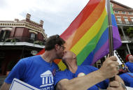 FILE - In this June 26, 2013, file photo, John Hill, chairman of the Forum For Equality in Louisiana, right, kisses his partner, John Weimer, Jr., at a celebration rally in Jackson Square in New Orleans, after two Supreme Court decisions supporting gay rights were handed down. New Orleans has long enjoyed a reputation in the South as a welcoming place for the lesbian and gay community. That reputation will be on display when the city hosts the NBA All-Star game next weekend. The game was awarded to New Orleans after the league decided to pull it from Charlotte last year. (AP Photo/Gerald Herbert, File)
