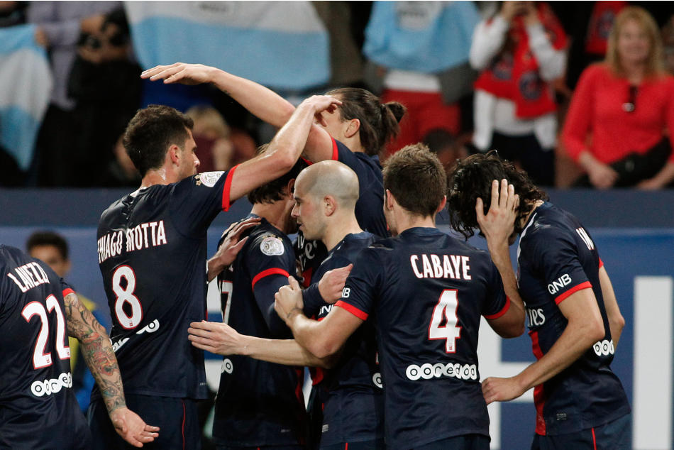 Paris Saint Germain's players celebrate after Paris Saint Germain's Zlatan Ibrahimovic scored, center, during their French League one soccer match against Saint Etienne, at the Parc des Prince