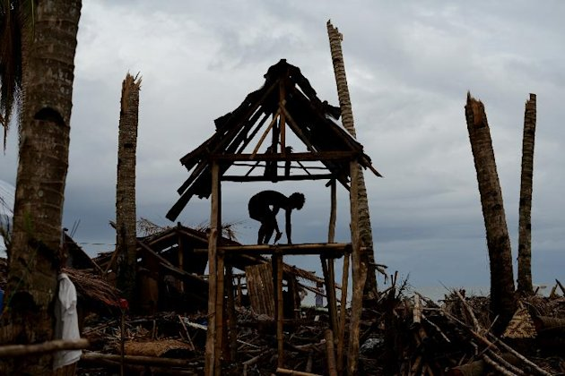 A Filipino rebuilds his damaged house in Basay, Samar province, on November 28, 2013