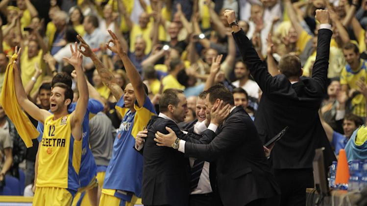 Maccabi Tel Aviv's Head Coach David Blatt, center left, and his coaches and team player celebrate their victory over Emporio Armani Milan in the end of the EuroLeague Basketball Group D playoff game against Maccabi Tel Aviv in Tel Aviv, Israel, Wednesday, April 23, 2014